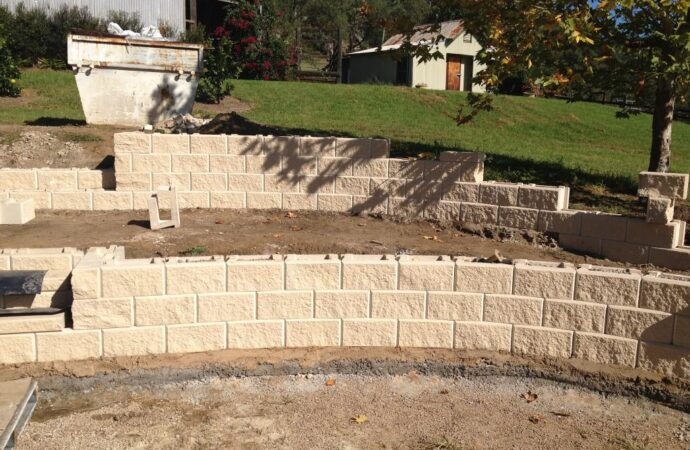 Retaining & Retention Walls-Grand Prairie TX Landscape Designs & Outdoor Living Areas-We offer Landscape Design, Outdoor Patios & Pergolas, Outdoor Living Spaces, Stonescapes, Residential & Commercial Landscaping, Irrigation Installation & Repairs, Drainage Systems, Landscape Lighting, Outdoor Living Spaces, Tree Service, Lawn Service, and more.